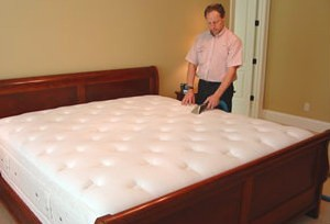 Man cleaning mattress